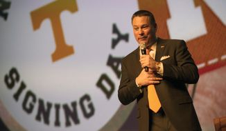 Tennessee head coach Butch Jones speaks during the university's NCAA college football recruiting celebration in Knoxville, Tenn., Wednesday, Feb. 5, 2014. (AP Photo/Knoxville News Sentinel, Adam Lau)