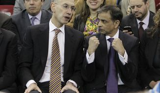Adam Silver, the new NBA Commissioner, talks with Sacramento Kings majority owner Vivek Ranadive as the Kings play the Toronto Raptors during the first quarter of an NBA basketball game in Sacramento, Calif., Wednesday, Feb. 5, 2014. Silver replaced David Stern Feb. 1,  who retired after 30 years as the head of the NBA. (AP Photo/Rich Pedroncelli)