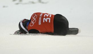 Norway's Anders  Jacobsen sits in the snow after falling in the first official ski jumping training at the 2014 Winter Olympics, Thursday, Feb. 6, 2014, in Krasnaya Polyana, Russia. (AP Photo/Gregorio Borgia)