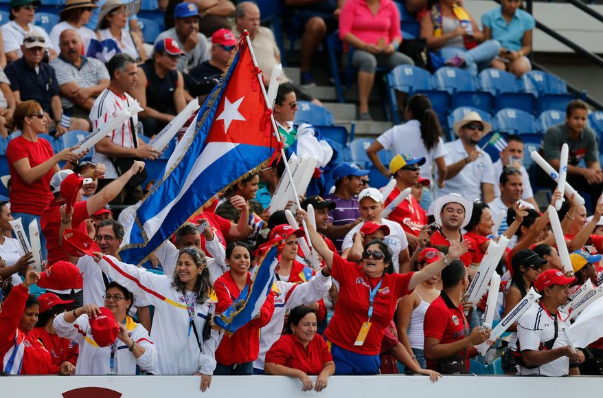 Cuba fans cheer for their team during a Caribbean Series baseball game against Puerto Rico in Porlamar, Venezuela, Tuesday, Feb. 4, 2014. (AP Photo/Fernando Llano)