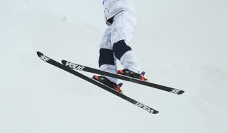 United States' Hannah Kearney jumps during qualifying in the women's moguls at the Rosa Kutor Exreme Park ahead of the 2014 Winter Olympics, Thursday, Feb. 6, 2014, in Krasnaya Polyana, Russia. (AP Photo/Sergei Grits)