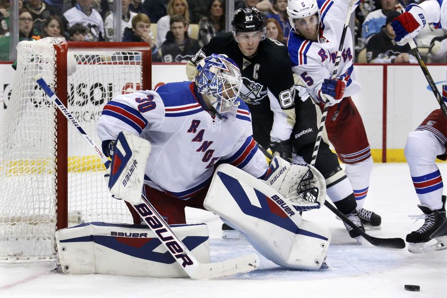 New York Rangers goalie Henrik Lundqvist (30) blocks a shot during the second period of an NHL hockey game as Rangers' Dan Girardi (5) battles Pittsburgh Penguins' Sidney Crosby (87) in Pittsburgh, Friday, Feb. 7, 2014. (AP Photo/Gene J. Puskar)