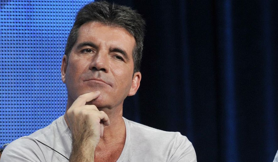 """This Aug. 1, 2013, file photo shows Simon Cowell, a judge on the FOX series """"The X Factor,"""" during a panel discussion on the show at the FOX 2013 Summer TCA press tour in Beverly Hills, Calif. (Photo by Chris Pizzello/Invision/AP, File)"""