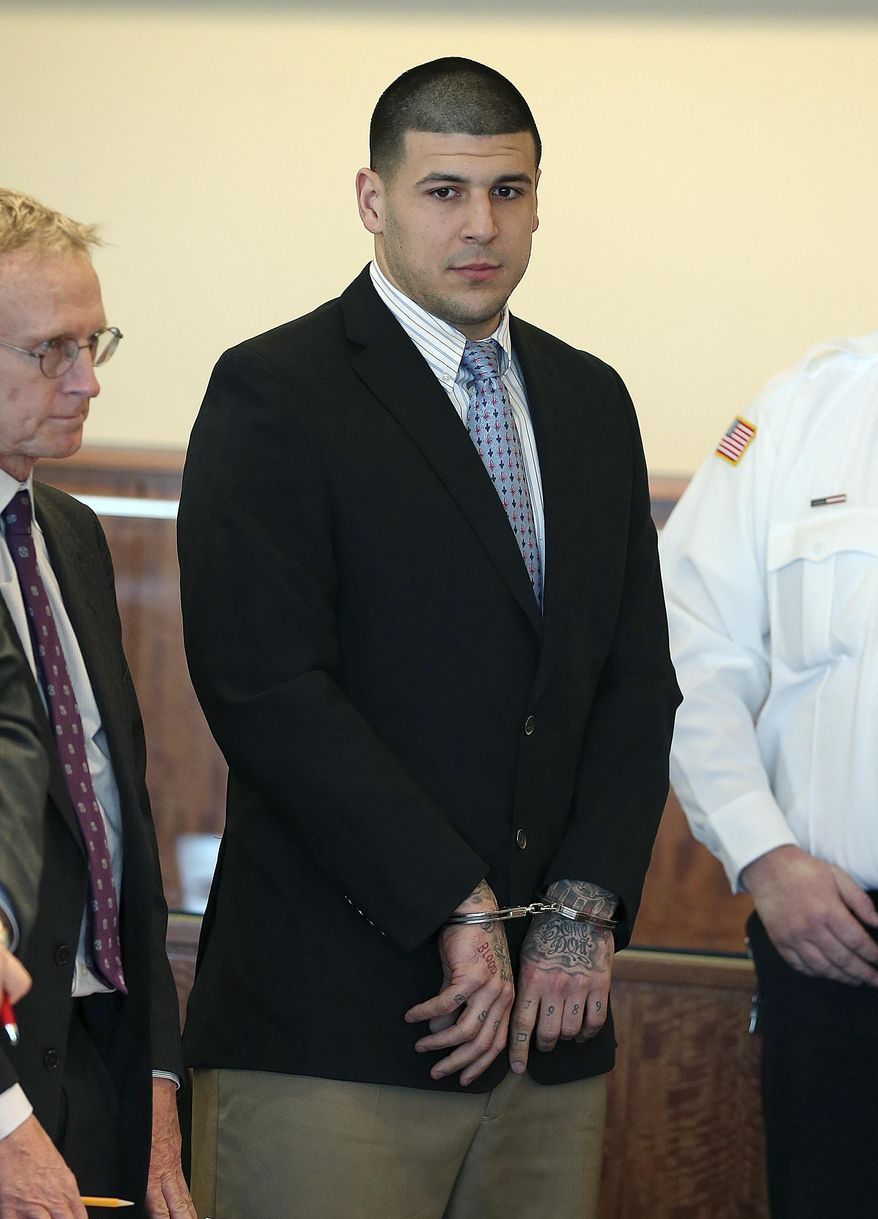 Former New England Patriots football player Aaron Hernandez stands during a hearing at Bristol Superior Court on Friday, Feb. 7, 2014, in Fall River, Mass. At the hearing, the judge rejected a request by prosecutors for Hernandez's jailhouse phone recordings, then ordered them to turn over to the defense copies of calls they acknowledged already having. The ex-NFL player has pleaded not guilty to murder in the killing of Odin Lloyd, a 27-year-old Boston man who was dating the sister of Hernandez's fiancee. Lloyd, a semi-professional football player was found dead June 17 near Hernandez's North Attleborough home. (AP Photo/The Boston Globe, Jonathan Wiggs, Pool)