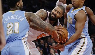 Denver Nuggets' Wilson Chandler (21) and Randy Foye (4) fight for control of the ball with New York Knicks' Tyson Chandler (6) during the first half of an NBA basketball game Friday, Feb. 7, 2014, in New York. (AP Photo/Frank Franklin II)