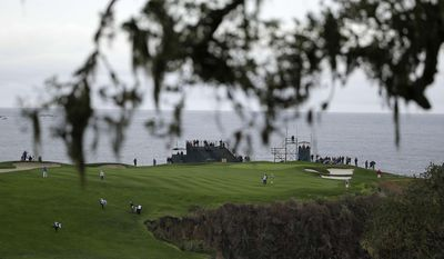 The playing group of Aaron Baddeley, Kenny G, Lucas Glover and Tom Dreesen make their way up to the sixth green of the Pebble Beach Golf Links during the second round of the AT&T Pebble Beach Pro-Am golf tournament on Friday, Feb. 7, 2014, in Pebble Beach, Calif. (AP Photo/Eric Risberg)