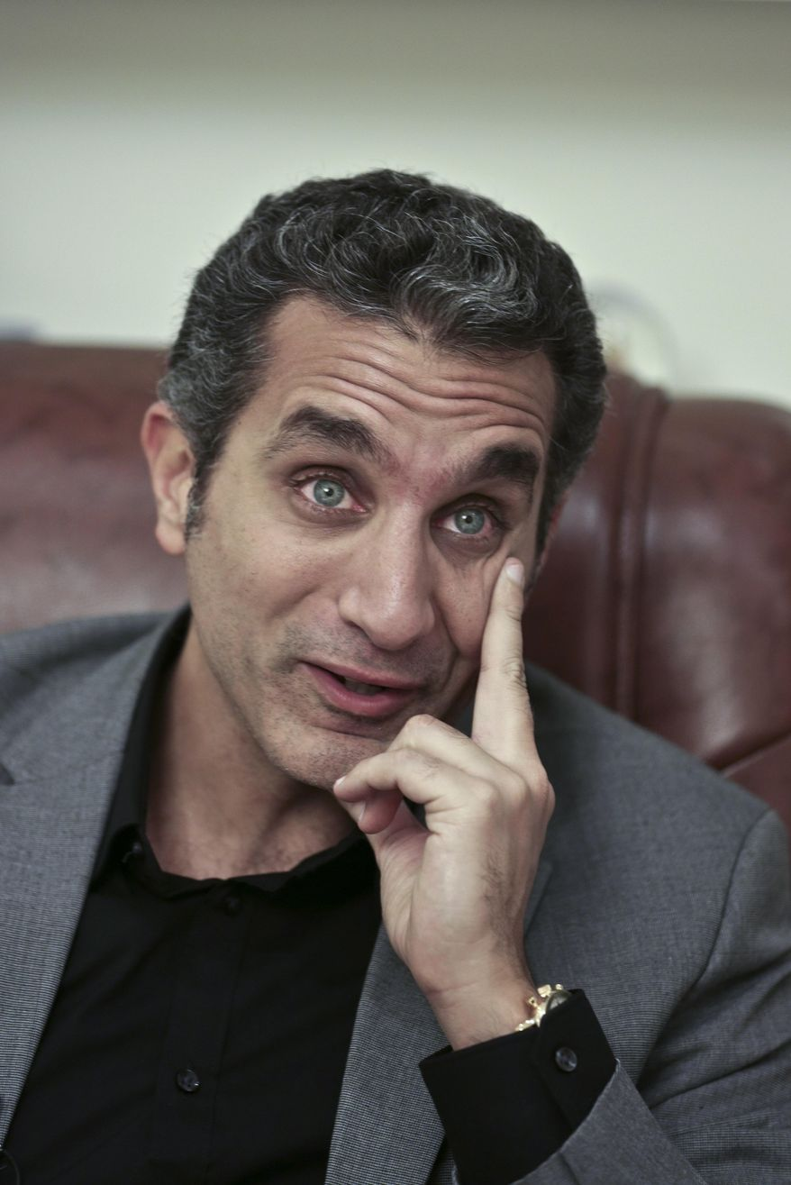 FILE - In this file photo taken Wednesday, Jan. 8, 2014, Egyptian satirist Bassem Youssef speaks during an interview with The Associated Press in Cairo, Egypt. Youssef was back on air on Friday, Feb. 7, true to his style of mocking the euphoria gripping Egyptians surrounding the country's military chief Abdel-Fattah el-Sissi, who is widely expected to run for president. Private broadcaster CBC had suspended Youssef's show last fall after the season's first episode, but he returned on a different broadcaster. (AP Photo/Nariman El-Mofty, File)