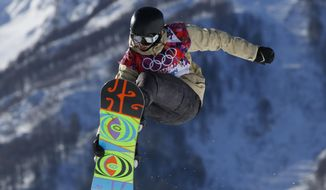 Austria's Adrian Krainer takes a jump during the men's snowboard slopestyle qualifying at the Rosa Khutor Extreme Park ahead of the 2014 Winter Olympics, Thursday, Feb. 6, 2014, in Krasnaya Polyana, Russia.  (AP Photo/Sergei Grits)