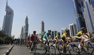 Cyclists start the third day, known as the Nature Stage of Dubai Tour in Dubai, United Arab Emirates, Friday, Feb. 7, 2014. (AP Photo/Kamran Jebreili)