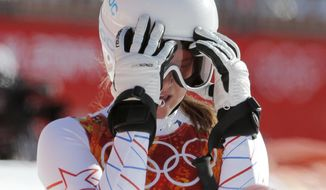 United States' Julia Mancuso takes off her goggles after a women's downhill training run for the Sochi 2014 Winter Olympics, Friday, Feb. 7, 2014, in Krasnaya Polyana, Russia. (AP Photo/Christophe Ena)