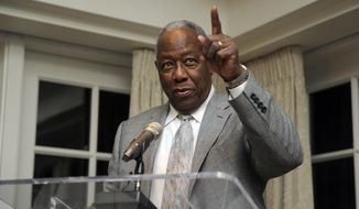 Baseball Hall of Famer Hank Aaron speaks at a reception in his honor, Friday, Feb. 7, 2014, in Washington. Aaron is turning 80 and is being celebrated with a series of events in Washington. (AP Photo/Nick Wass)
