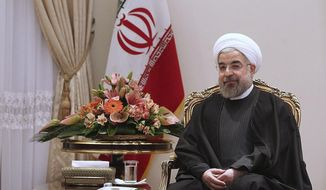 In this photo released by the official website of the office of the Iranian Presidency, President Hassan Rouhani sits in a meeting with Swedish Foreign Minister Carl Bildt at the Presidency compound in Tehran, Iran, Tuesday, Feb. 4, 2014. Iran's official IRNA news agency quoted President Hassan Rouhani as saying his country is ready for final nuclear talks with world powers. The Tuesday remarks came during a meeting with visiting Swedish Minister for Foreign Affairs Carl Bildt. (AP Photo/Presidency Office, Mohammad Berno)