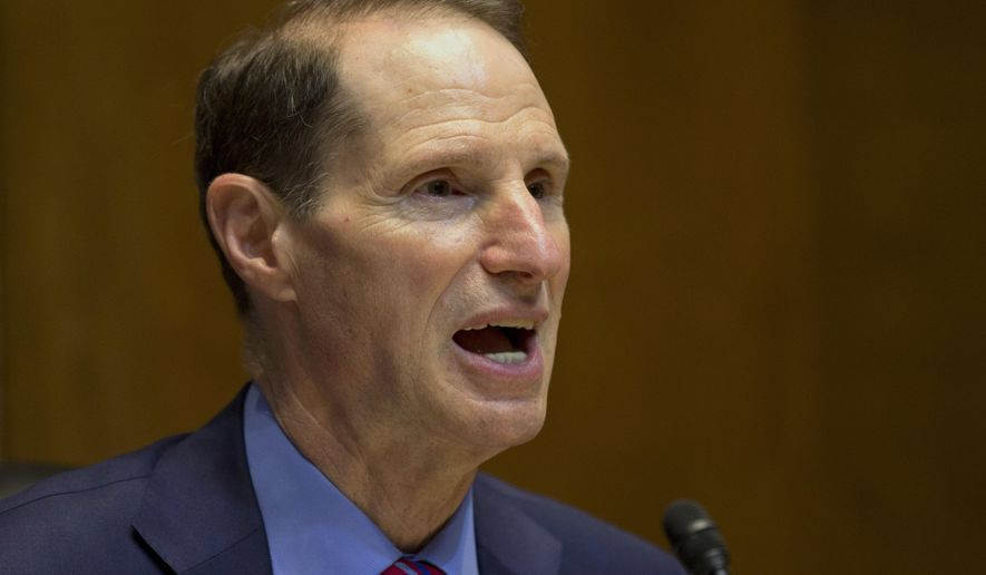 FILE - In this June 6, 2013, file photo, Sen. Ron Wyden, D-Ore. speaks on Capitol Hill in Washington. Wyden, the incoming chairman of the Senate Finance Committee says he would make revamping the federal income tax system a top priority. (AP Photo/Jacquelyn Martin, File)
