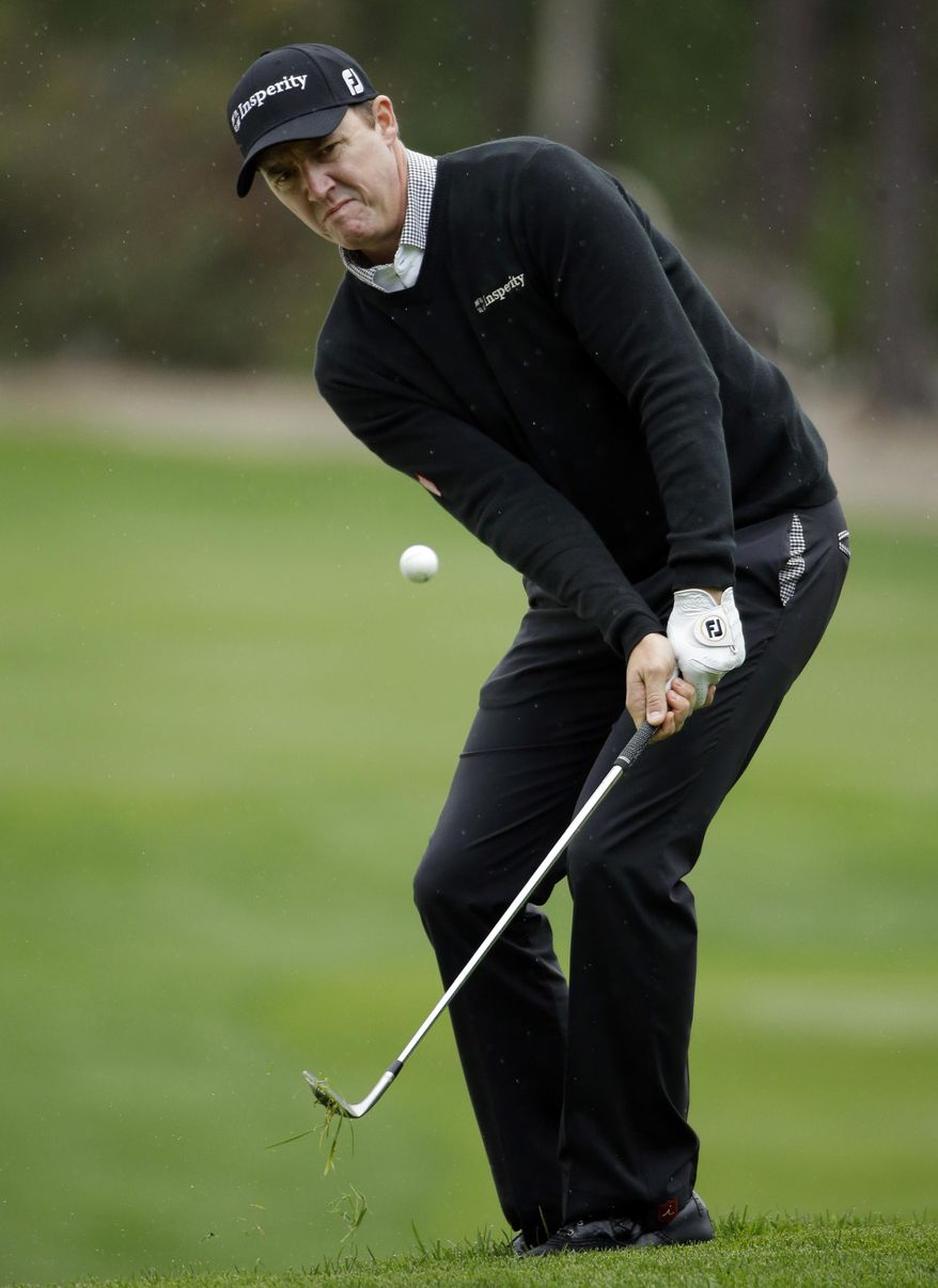 Jimmy Walker chips onto the sixth green on Friday, Feb. 7, 2014, during the second round of the AT&T Pebble Beach Pro-Am golf tournament on the Spyglass Hill Golf Course in Pebble Beach, Calif. (AP Photo/Ben Margot)