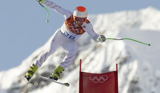 United States' Steven Nyman makes a jump during a men's downhill training run for the Sochi 2014 Winter Olympics, Friday, Feb. 7, 2014, in Krasnaya Polyana, Russia. (AP Photo/Charles Krupa)