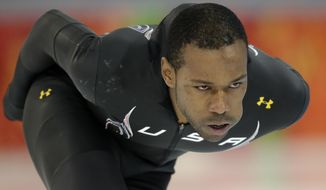 Speedskater Shani Davis of the U.S. trains at the Adler Arena Skating Center during the 2014 Winter Olympics in Sochi, Russia, Friday, Feb. 7, 2014. (AP Photo/Patrick Semansky)