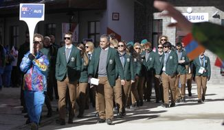 Members of the Australian Olympic team arrive for a welcome ceremony at the Mountain Olympic Village prior to the 2014 Winter Olympics, Thursday, Feb. 6, 2014, in Krasnaya Polyana, Russia. (AP Photo/Jae C. Hong)