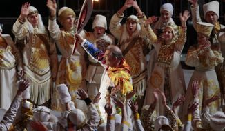 Vladislav Tretiak carries the torch during the opening ceremony of the 2014 Winter Olympics in Sochi, Russia, Friday, Feb. 7, 2014. (AP Photo/Ivan Sekretarev)
