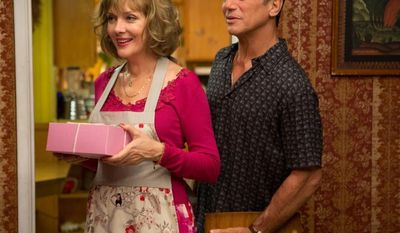 "Glenne Headly and Tony Danza appear in a scene from ""Don Jon."""