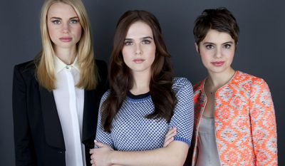 """This Jan. 28, 2014 photo shows co-stars of the film """"Vampire Academy,"""" from left, Lucy Fry, Zoey Deutch and Sami Gayle posing for a portrait in New York. (Photo by Amy Sussman/Invision/AP)"""