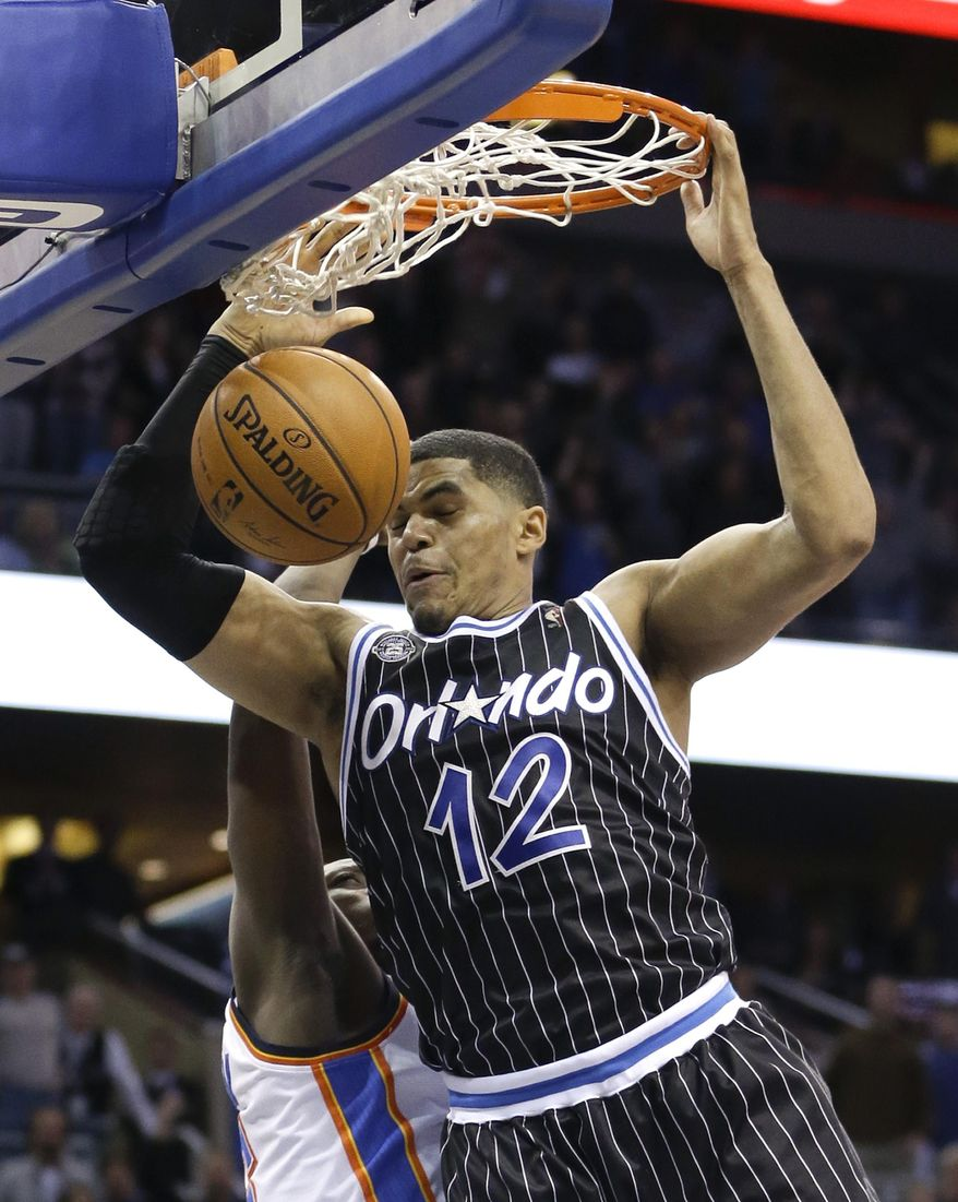 Orlando Magic's Tobias Harris (12) dunks the ball in front of Oklahoma City Thunder's Reggie Jackson at the buzzer to win an NBA basketball game 103-102 in Orlando, Fla., Friday, Feb. 7, 2014. (AP Photo/John Raoux)