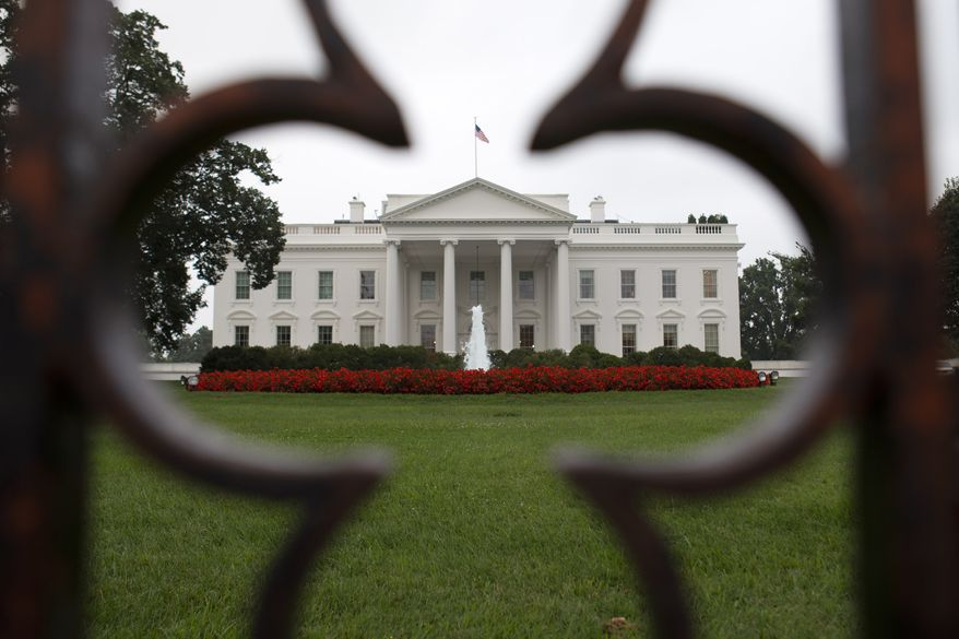 **FILE** The White House is seen through a keyhole in the fence on Aug. 29, 2013. (Associated Press)