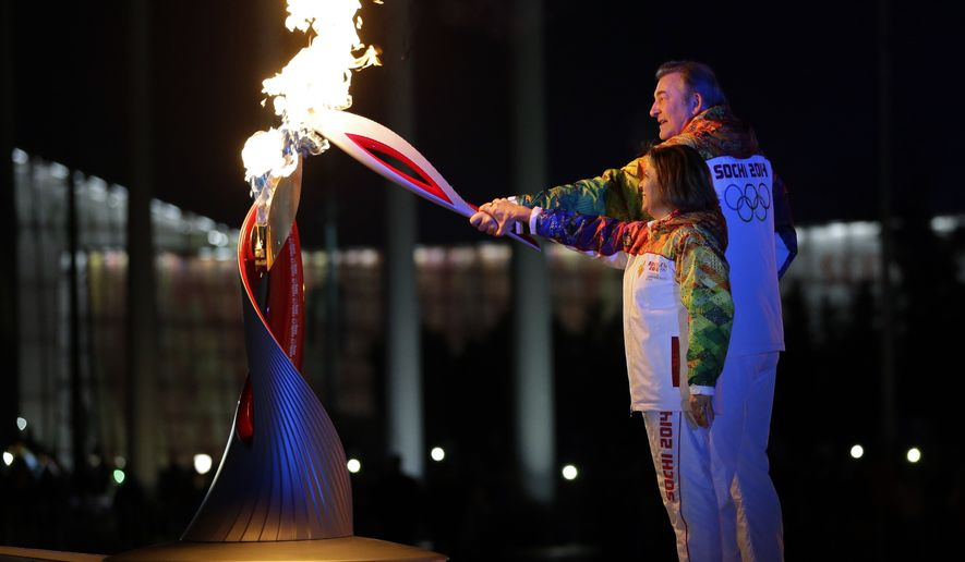 Irina Rodnina and Vladislav Tretyak light the Olympic cauldron during the opening ceremony of the 2014 Winter Olympics in Sochi, Russia, Friday, Feb. 7, 2014. (AP Photo/Matt Slocum, Pool)