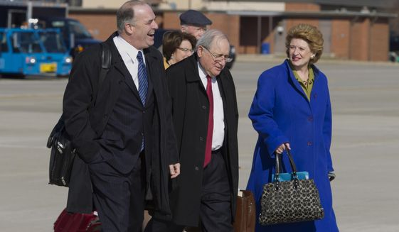 From left, Rep. Dan  Kildee D-Mich., Sen. Carl Levin  D-Mich., and Senate Agriculture Committee Chair Sen. Debbie Stabenow D-Mich., walk toward Air Force One before President Barack Obama's arrival, Friday, Feb. 7, 2014, at Andrews Air Force Base, Md. The group traveled with the president to East Lansing, Mich. where the president was to sign the farm bill at Michigan State University. ( AP Photo/Jose Luis Magana)