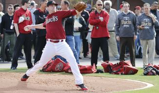 Arizona Diamondbacks pitcher Archie Bradley runs drills during the teams first baseball spring training workout, Friday, Feb. 7, 2014, in Scottsdale, Ariz. (AP Photo/Matt York)
