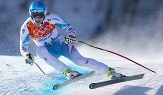 Austria's Matthias Mayer makes a turn in a men's downhill training run for the Sochi  2014 Winter Olympics, Friday, Feb. 7, 2014, in Krasnaya Polyana, Russia. (AP Photo/Alessandro Trovati)