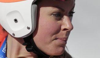 Britain's Chemmy Alcott stands in the finish area after a women's downhill training run for the 2014 Winter Olympics, Thursday, Feb. 6, 2014, in Krasnaya Polyana, Russia. (AP Photo/Gero Breloer)