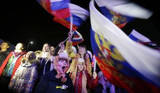 A Russian child yawns while others wave the national flag as the Russian national anthem is played during the live telecast of the 2014 Winter Olympics opening ceremony, Friday, Feb. 7, 2014, in downtown Sochi, Russia. (AP Photo/Wong Maye-E)