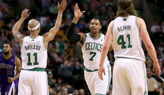 Boston Celtics center Jared Sullinger (7) celebrates with teammates Jerryd Bayless (11) and Kelly Olynyk (41) after scoring during the second half of an NBA basketball game against the Sacramento Kings, Friday, Feb. 7, 2014, in Boston. Sullinger scored 31 points and the Celtics won 99-89. (AP Photo/Mary Schwalm)
