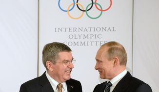 IOC President Thomas Bach, left, welcomes Russian President Vladimir Putin before the IOC President?'s Gala Dinner on the eve of the opening ceremony of the 2014 Winter Olympics, Thursday, Feb. 6, 2014, in Sochi, Russia.  (AP Photo/Andrej Isakovic, Pool)