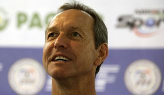 """Former U.S. captain Thomas Dooley poses for photographers following his appointment as the new head coach of the Philippine national football team known as """"Azkals"""" Friday, Feb. 7, 2014 at suburban Pasig city, east of Manila, Philippines. Dooley, who replaced German coach Michael Weiss, will start immediately preparing the team for the Challenge Cup in May in the Maldives. It will be Dooley's first time to coach a national team and he said he is """"very honored, humbled and very excited to take this task."""" (AP Photo/Bullit Marquez)"""
