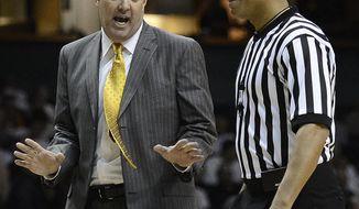 Vanderbilt head coach Kevin Stallings talks with an official in the second half of an NCAA college basketball game against Tennessee, Wednesday, Feb. 5, 2014, in Nashville, Tenn. Vanderbilt won 64-60. (AP Photo/Mark Zaleski)