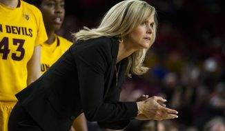 Arizona State coach Charli Turner Thorne watches her team take on Arizona during an NCAA college basketball game Tuesday, Feb. 4, 2014, in Tempe, Ariz. (AP Photo/The Arizona Republic, Stacie Scott) MESA OUT  MARICOPA COUNTY OUT  MAGS OUT  NO SALES