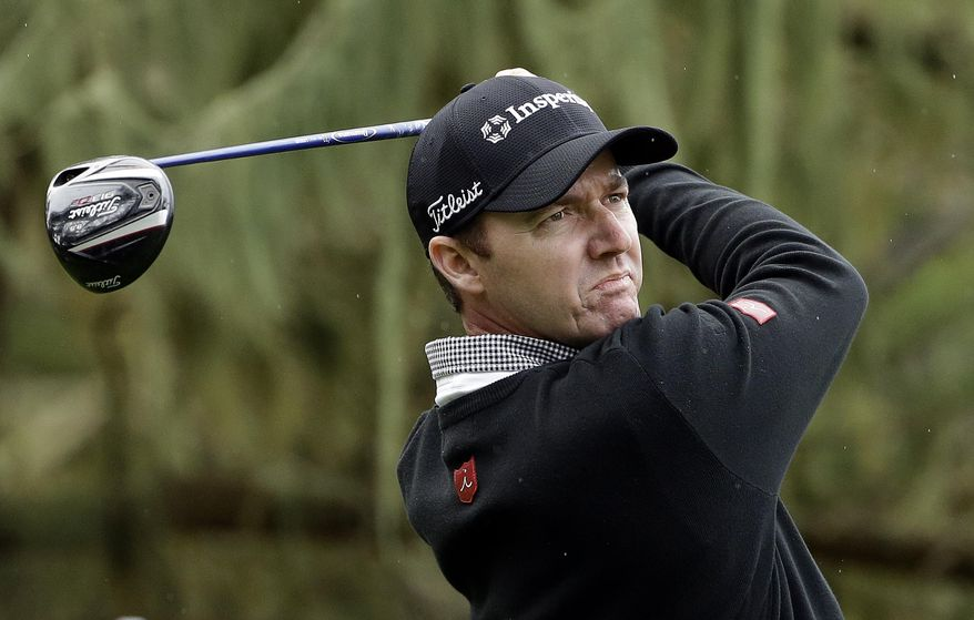 Jimmy Walker hits off the seventh tee on Friday, Feb. 7, 2014, during the second round of the AT&T Pebble Beach Pro-Am golf tournament on the Spyglass Hill Golf Course in Pebble Beach, Calif. (AP Photo/Ben Margot)