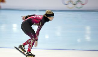 Speedskater Claudia Pechstein of Germany trains at the Adler Arena Skating Center during the 2014 Winter Olympics in Sochi, Russia, Thursday, Feb. 6, 2014. (AP Photo/Peter Dejong)