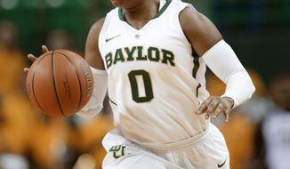 ADVANCE FOR WEEKEND, FEB. 8-9 - In this Nov. 14, 2013, photo, Baylor guard Odyssey Sims brings the ball up against Nicholls State during an NCAA college basketball game in Waco, Texas. Sims became Baylor's starting point guard as a freshman and almost made it to the NCAA Final Four. She did help the Lady Bears to an undefeated national title as a sophomore, and was part of another deep tourney run last season. (AP Photo/Tony Gutierrez)