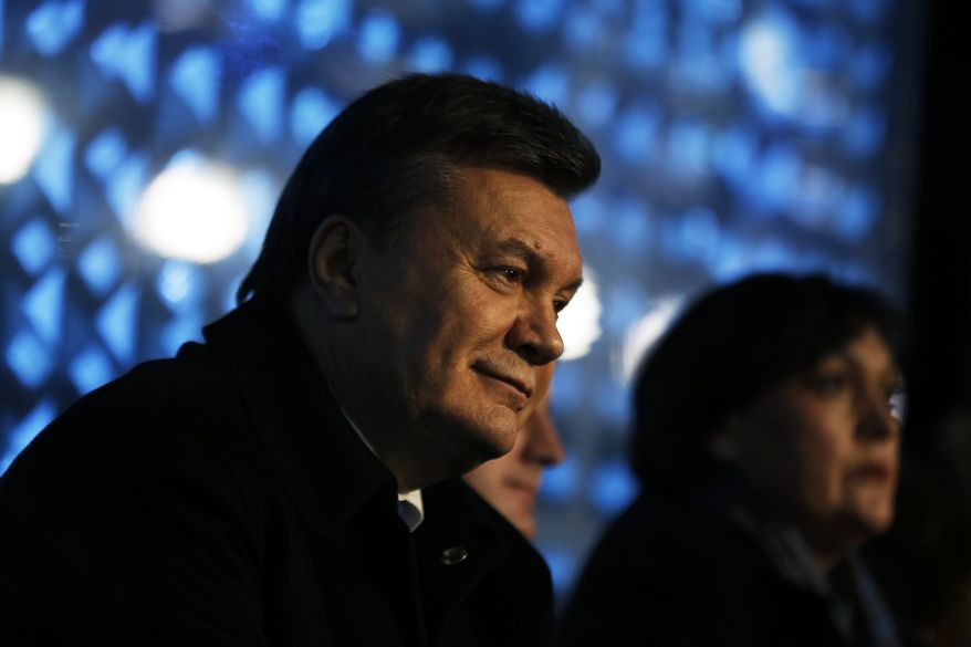 Ukrainian President Viktor Yanukovych watches the opening ceremony of the 2014 Winter Olympics, Friday, Feb. 7, 2014, in Sochi, Russia. (AP Photo/David Goldman, Pool)
