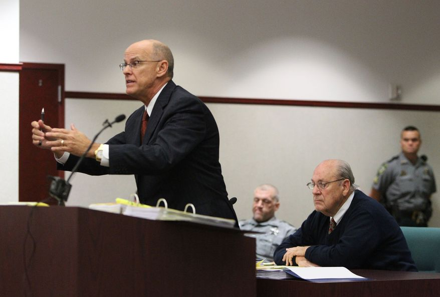 Former Tampa Police captain Curtis Reeves, Jr., right, sits as his attorney Richard Escobar, left, cross examines Pasco Sheriff's detective Allen Proctor during Reeves' bond reduction hearing before Circuit Judge Pat Siracusa at the Robert D. Sumner Judicial Center in Dade City Friday, Feb. 7, 2014.  Reeves is suspected of fatally shooting Chad Oulson, 43, and wounding his wife, Nicole, 33, during an argument Jan. 13 over texting at the Cobb Grove 16 theater in Wesley Chapel, Fla.  (AP Photo/Pool Tampa Bay Times, Brendan Fitterer, Pool)