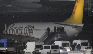 "Passengers of private Turkish company Pegasus leave the plane at the Sabiha Gokcen Airport in Istanbul, Turkey, Friday, Feb. 7, 2014. An official says authorities have subdued a man who attempted to hijack a Turkish plane to Sochi, Russia, and that the other passengers have been evacuated. Huseyin Avni Mutlu, the Istanbul governor, says on Twitter that ""the operation has ended."" In another tweet Friday, he said all passengers were evacuated ""without any problems.""(AP Photo/Emrah Gurel)"