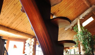 A custom built staircase begun by Neil Weishahn, formerly of Ketchikan, Alaska with a rail by John Stewart, adorns the living room of Martha Jacobson's Ketchikan home. (AP Photo/Ketchikan Daily News, Hall Anderson)
