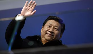 China's President Xi Jinping waves from the presidential tribune during the opening ceremony of the 2014 Winter Olympics in Sochi, Russia, Friday, Feb. 7, 2014. (AP Photo/Lionel Bonaventure, Pool)