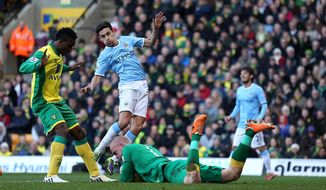 Norwich City's goalkeeper John Ruddy saves at the feet of Manchester City's Gonzalez Jesus Navas during the English Premier League match at Carrow Road, Norwich Saturday Feb.  8, 2014. (AP Photo/ Chris Radburn/PA) UNITED KINGDOM OUT - NO SALES - NO ARCHIVES