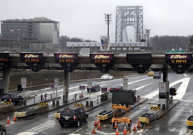 """FILE - In this Jan. 11, 2014, file photo, traffic passes through the toll booths at the George Washington Bridge, in Fort Lee, N.J.  On paper, David Wildstein's title at the Port Authority of New York and New Jersey was """"Director of Interstate Capital Projects."""" But many who worked there knew his real job, a post created just for him in 2010, was to further Republican Gov. Chris Christie's agenda inside the agency.He led efforts to give New Jersey officials more sway over authority operations. Now, the man who was known as the administration's eyes and ears at the Port Authority may be the public's best chance of knowing the truth behind a plan last summer to purposely create days of traffic gridlock in Fort Lee, N.J., by choking off local access to the George Washington Bridge.(AP Photo/Richard Drew, File)"""