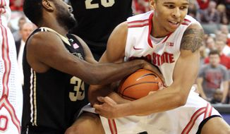 Ohio State's Marc Loving, right, fights for control with Purdue's Rapheal Davis (35) during the first half of an NCAA college basketball game Saturday, Feb. 8, 2014, in Columbus, Ohio. (AP Photo/Mike Munden)