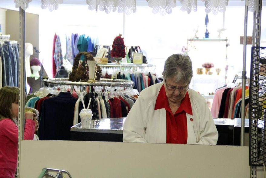 FOR RELEASE SATURDAY, FEB. 8, 2014, AT 12:01 A.M. CST. AND THEREAFTER - In this Feb. 1, 2014 photo, Children's Guild volunteer Vivian Schuster sorts out the register at the Bargain Box, a small secondhand shop in Beatrice, Neb. The store is staffed entirely by volunteers. All profits are donated to MOSAIC in Beatrice, an organization devoted to supporting people with intellectual disabilities. (AP Photo/Beatrice Daily Sun, Casey Welsch)