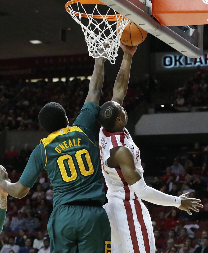 Oklahoma guard Buddy Hield, right, shoots in front of Baylor forward Royce O'Neale (00) in the second half of an NCAA college basketball game in Norman, Okla., Saturday, Feb. 8, 2014. Oklahoma won 88-72. (AP Photo/Sue Ogrocki)